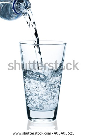 pouring water from bottle into glass isolated on white background - stock photo