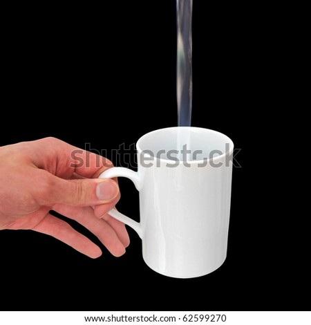 Pouring water into a white mug isolated on black background - stock photo