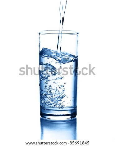 pouring water isolated on a white background - stock photo