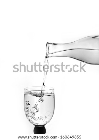 pouring water on a glass  - stock photo
