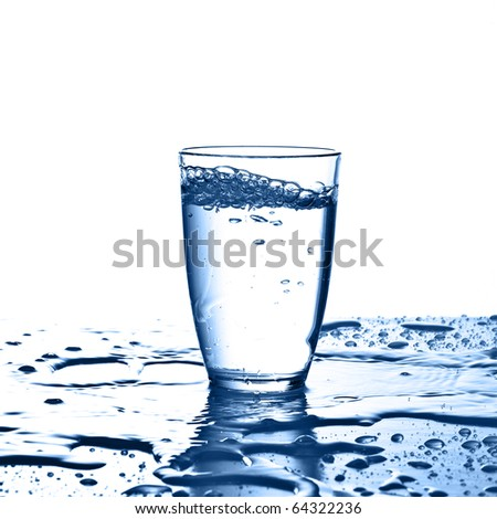 pouring water on a glass on a white background - stock photo