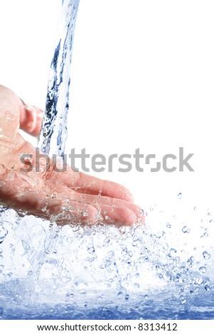 Pouring water splashing on hand - stock photo