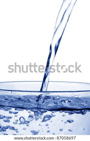 pouring water with bubbles - stock photo