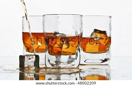 pouring whiskey glass - stock photo