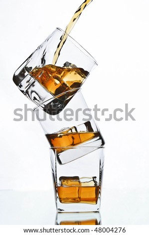 pouring whiskey in glass - stock photo