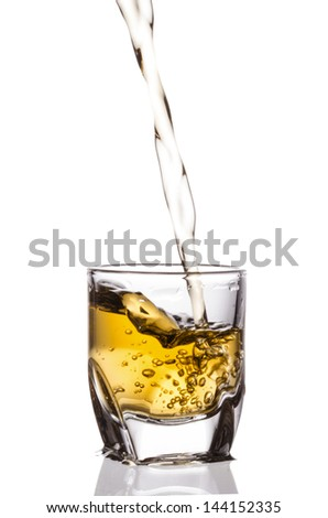 pouring whiskey isolated on white background - stock photo
