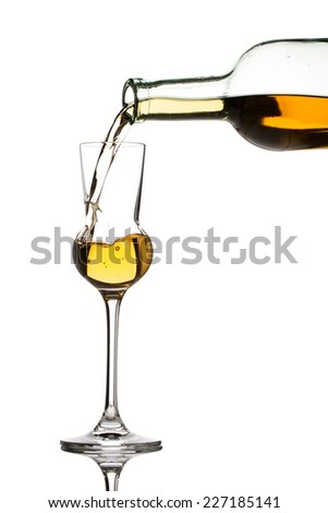 pouring whisky - glass and bottle isolated on white background - stock photo
