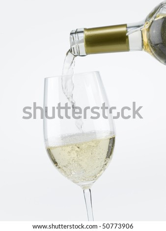 Pouring White Wine in a Glass - stock photo