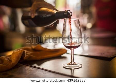 Pouring wine - stock photo