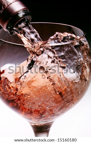Pouring wine close-up - stock photo