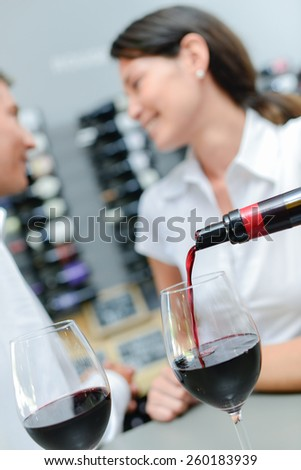 Pouring wine  for a couple - stock photo