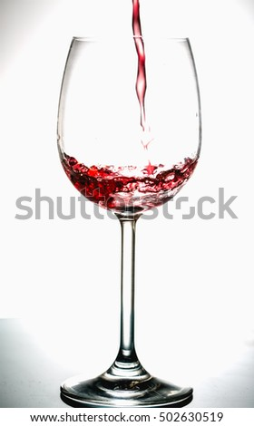 Pouring wine into the glasses, white background, isolated