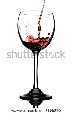 Pouring Wine on a Wineglass and reflection - stock photo
