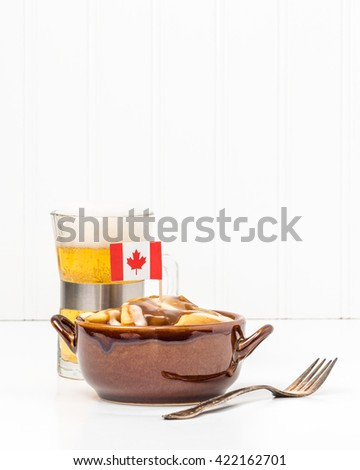Poutine is a uniquely Canadian dish originating from the Province of Quebec. - stock photo