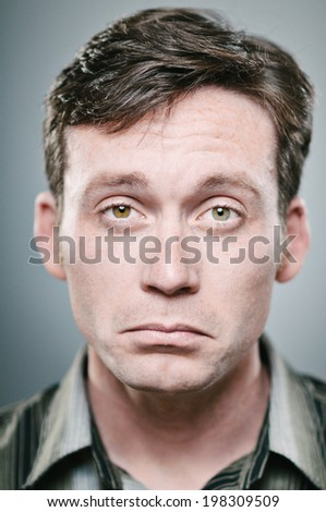 Pouting adult Caucasian man - stock photo