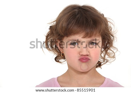 Pouting little girl - stock photo