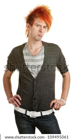Pouting male Caucasian teenager with hands on hips - stock photo