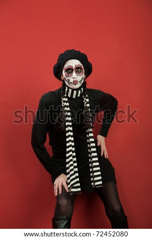 Pouting woman in facepaint for All Saints Day - stock photo