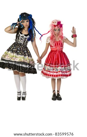 Pouty faced doll character with pink hair and pink dress - stock photo