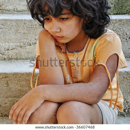 Poverty and poorness on the expression of children - stock photo