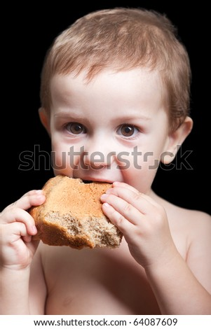 Poverty people little child boy eating bread food - stock photo