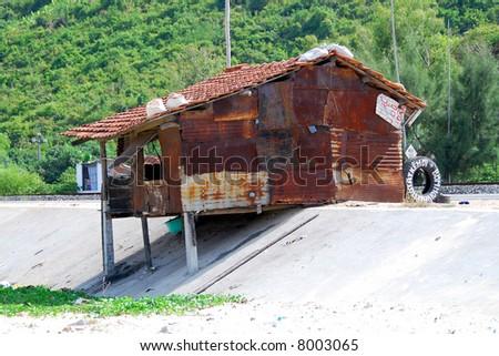 poverty tire shop in vietnam - stock photo