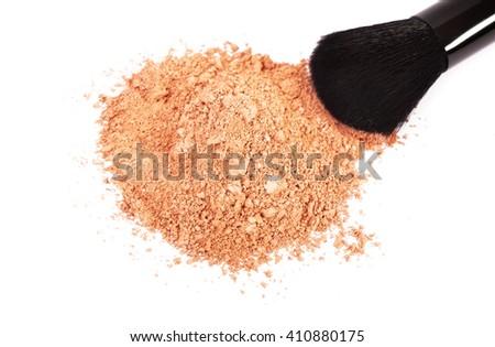 Powder blush and black makeup brush on white background - stock photo