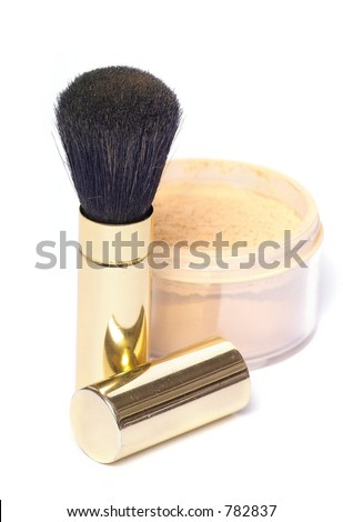 powder brush in golden case with loose powder - stock photo