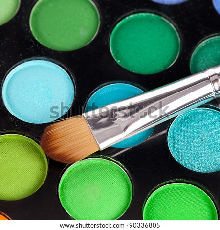 powder brush  multicolour background - stock photo