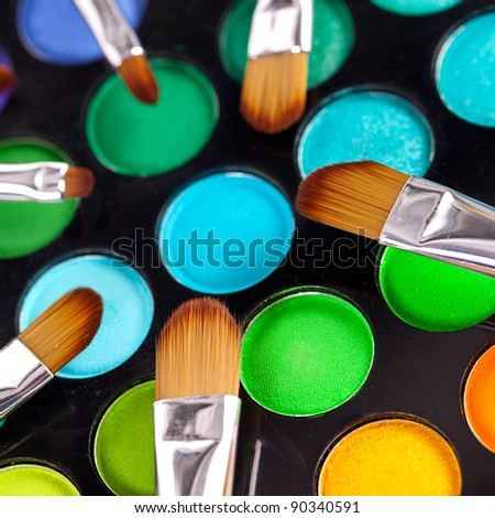 powder brushes  multicolour background - stock photo