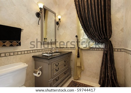 Powder room in luxury home with elegant draperies - stock photo