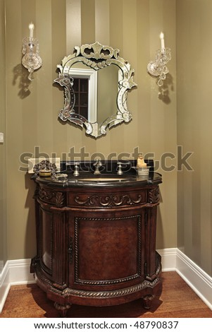 Powder room in luxury home with oval sink - stock photo