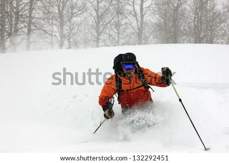 Powder skier in deep snow during a blizzard, Utah, USA. - stock photo