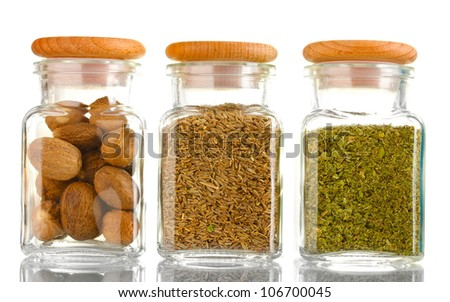 powder spices in glass jars  isolated on white - stock photo
