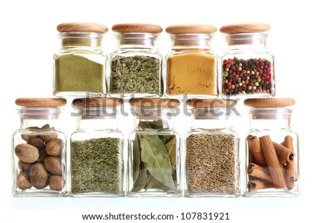 powder spices in glass jars  isolated on white
