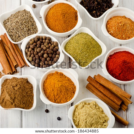 powder spices on a wooden table. Selective focus