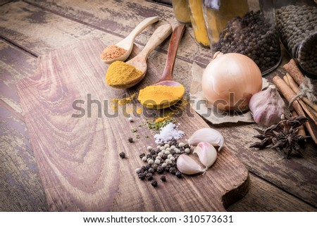 Powder spices on spoons in wooden table background - stock photo