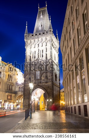 Powder tower (gate) at evening in Prague, Czech Republic. It is one of the original city gates, dating back to the 11th century. It is one of the symbols of Prague leading into the Old Town - stock photo