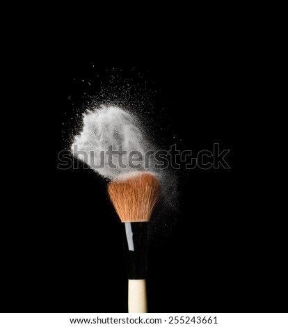 powderbrush isolated on black background close up - stock photo