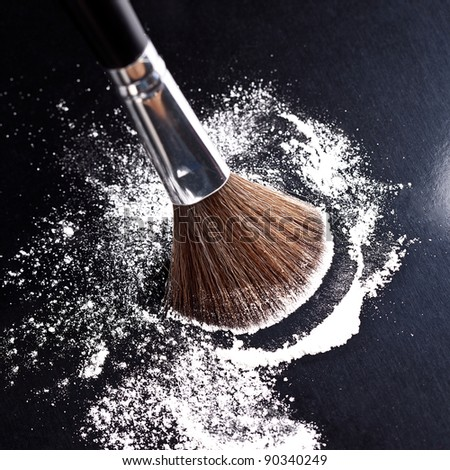 powderbrush on black background - stock photo