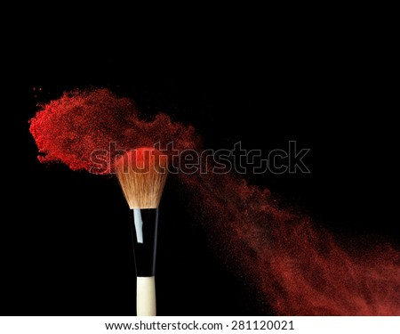 powderbrush on black background with blue powder splash close up - stock photo