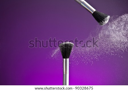 powderbrush on purple background - stock photo