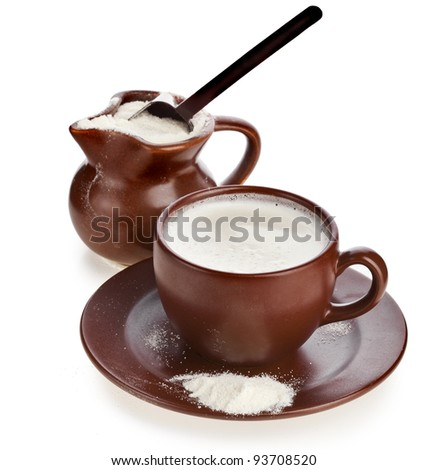 powdered milk drink in clay  pitcher on white background - stock photo