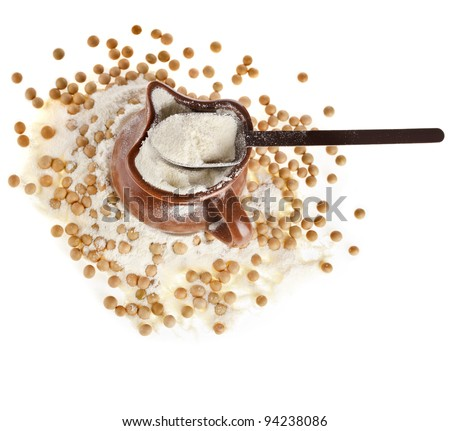 powdered milk drink in clay pitcher , soy beans on white background - stock photo