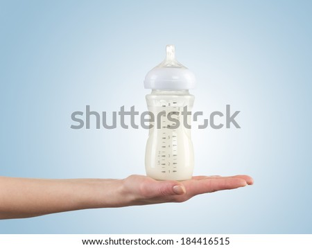 Powdered milk in bottle, dairy food for baby. - stock photo