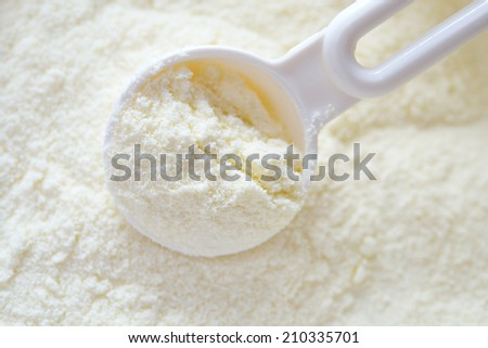 Powdered milk with spoon for baby - stock photo