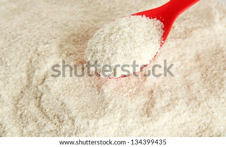 Powdered milk with spoon for baby close-up - stock photo