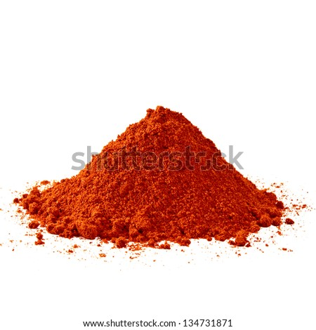 Powdered red pepper pile on white background - stock photo