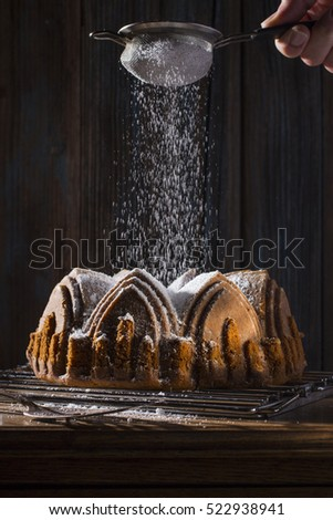 Powdered Sugar Being Dusted Over Apple Spice Cake