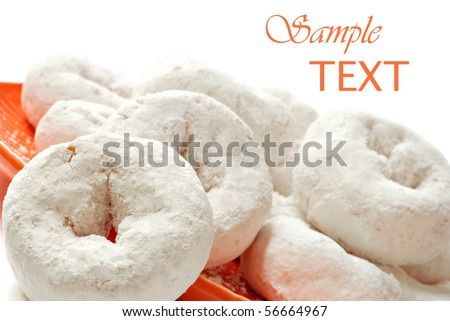 Powdered sugar mini donuts on white background with copy space.  Macro with shallow dof. - stock photo